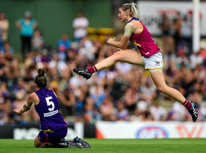 Tayla Harris of the Lions kicks into attack against the Fremantle Dockers.