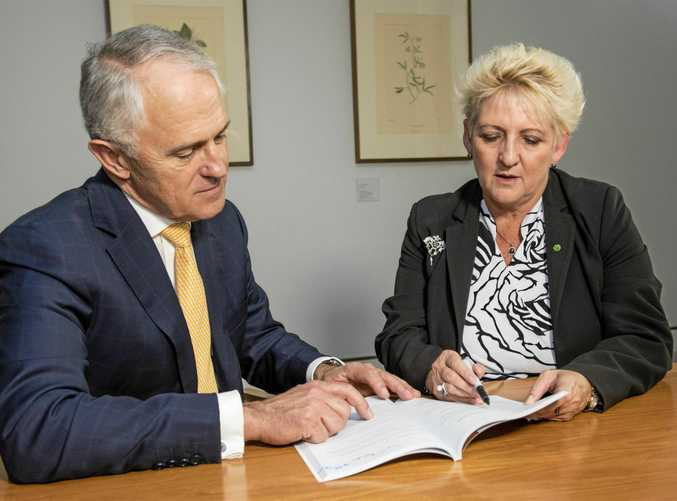 VOTE WINNER: Prime Minister Malcolm Turnbull with Capricornia MP Michelle Landry going over the Shoalwater Bay expansion.