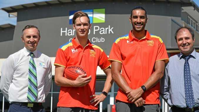 Harrup Park general manager Michael Jones (left), Gold Coast Suns Jack Scrimshaw and Tom Nicholls and Cr Ayril Paton.