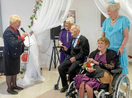 The wedding party, with celebrant Jeannie Pienaar, Elaine and Laurie Stephenson, and Vorna Cooper (in blue) with 103-year-old maid of honour Irene Crispin and best dog Leo.