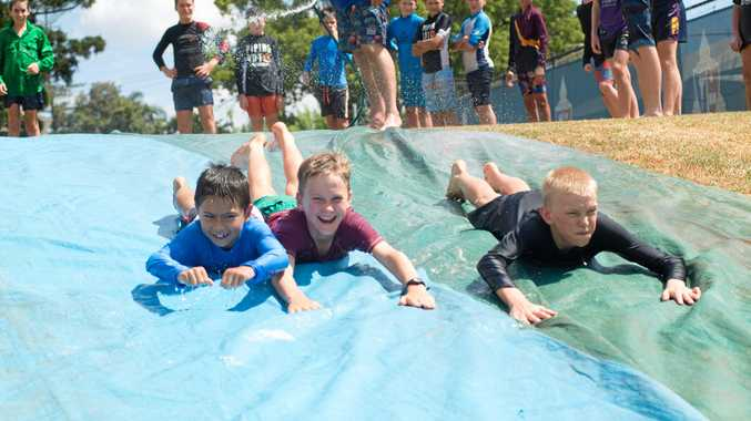 SLIP 'N' SLIDE: Cooling off are (from left) Sonny Lees, Joseph Anderson and Josh Brimblecombe.