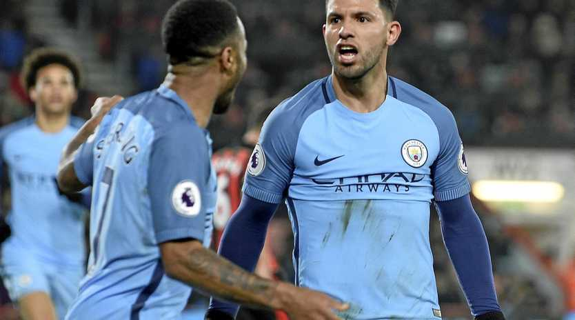 Manchester City's Sergio Aguero (right) and with Raheem Sterling celebrate their side's second goal against Bournemouth.