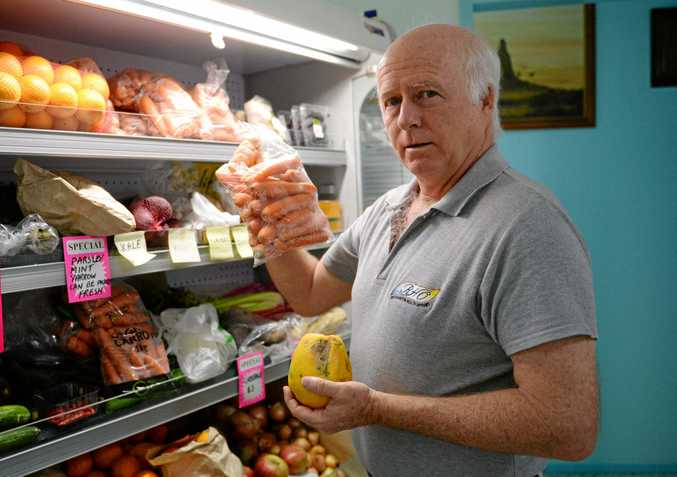 LIVING WELL: Naturopath Peter Lewis with some organic produce.