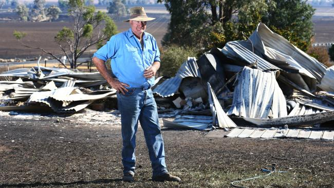Hero and victim... Fire chief Graham Goodman outside remains of his home