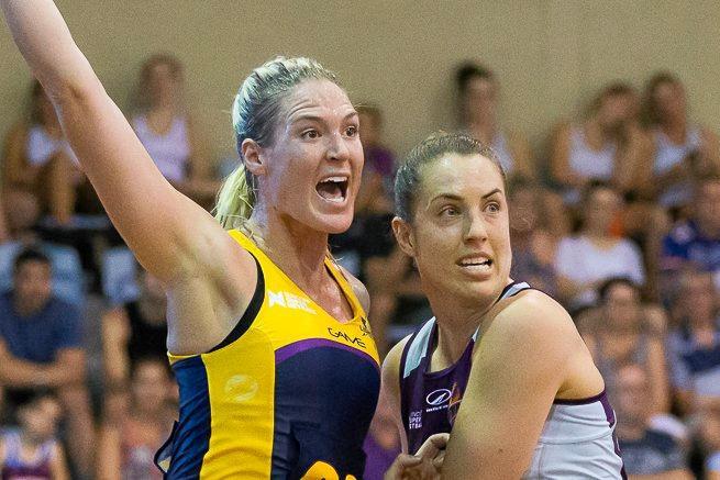 CONTEST: Sunshine Coast goal shooter Caitlin Bassett is marked by Firebirds goal keeper Laura Clemesha.
