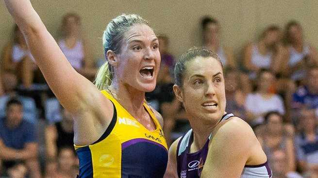 TOUGH: Sunshine Coast goal shooter Caitlin Bassett is marked by Firebirds keeper Laura Clemesha in a trial game.