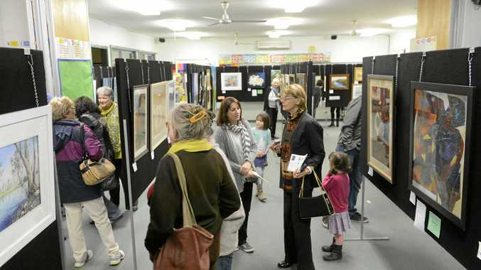 People take a look at the art section of the LCACA competitive exhbition after the prizegiving night on ThursdayPhoto Adam Hourigan / The Daily Examiner