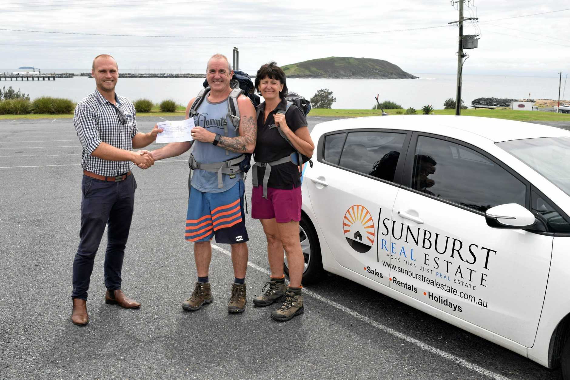 Darcy Kean hands over the first Sunburst cheque to Craig Semple and Lee-Ann Lloyd ahead of their Kokoda trek to raise money for the Black Dog Institute. Coffs Harbour, February 15, 2017.