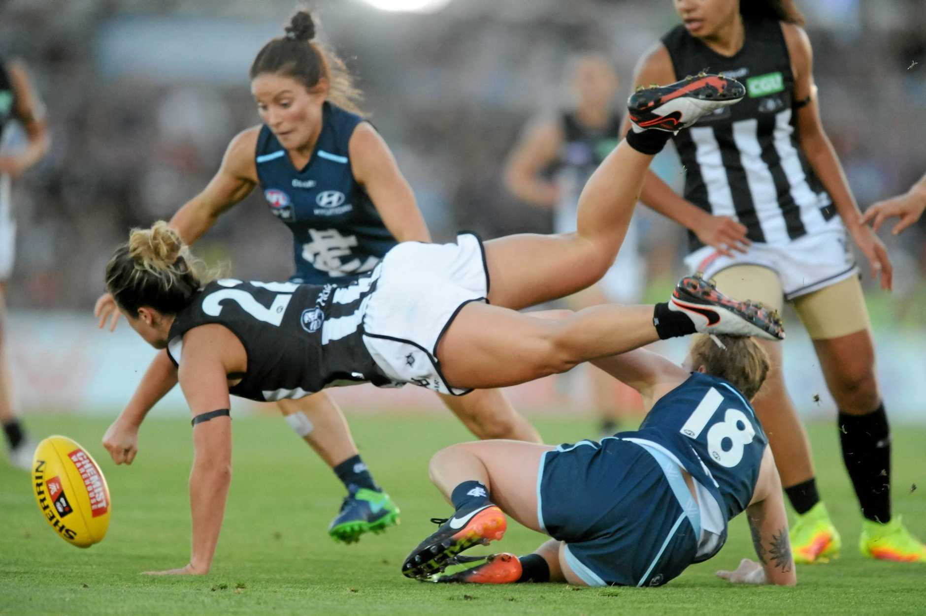 Sophie Casey of Collingwood dives over Tilly Lucas-Rodd of Carlton to reach the ball during their AFLW clash.