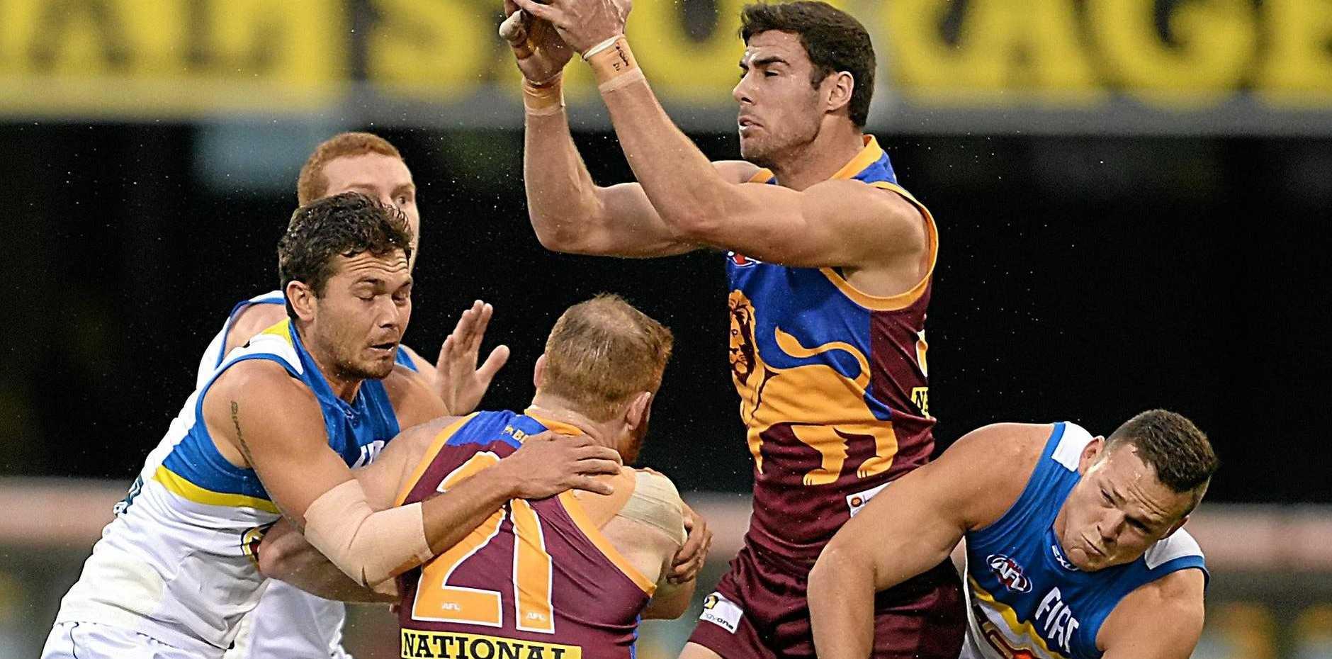 Michael Close of Brisbane Lions takes a mark.
