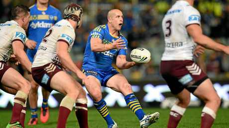 Jeff Robson of the Eels offloads a pass.