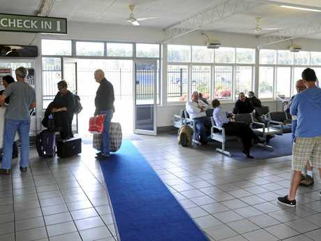 Travellers wait for the REX plane to arrive at Grafton airport  Photo Adam Hourigan / The Daily Examiner