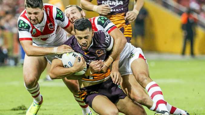 Jordan Kahu of the Broncos is tackled by Gareth Widdop (left) and Jason Nightingale of the Dragons.