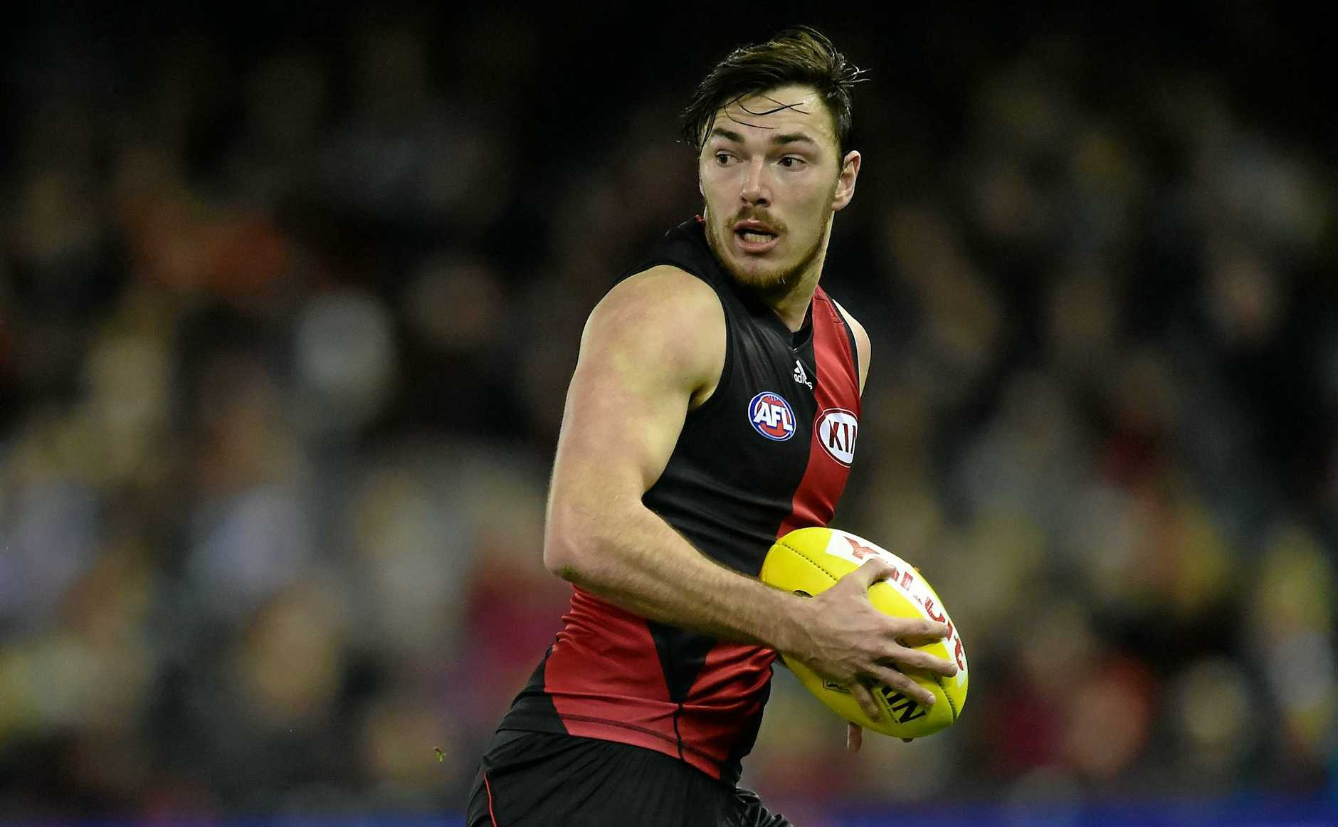 Essendon Bombers player Michael Hibberd possess the ball against the Western Bulldogs during round 18 of the AFL at Etihad Stadium in Melbourne, Sunday, Aug 2, 2015. (AAP Image/Julian Smith) NO ARCHIVING, EDITORIAL USE ONLY\