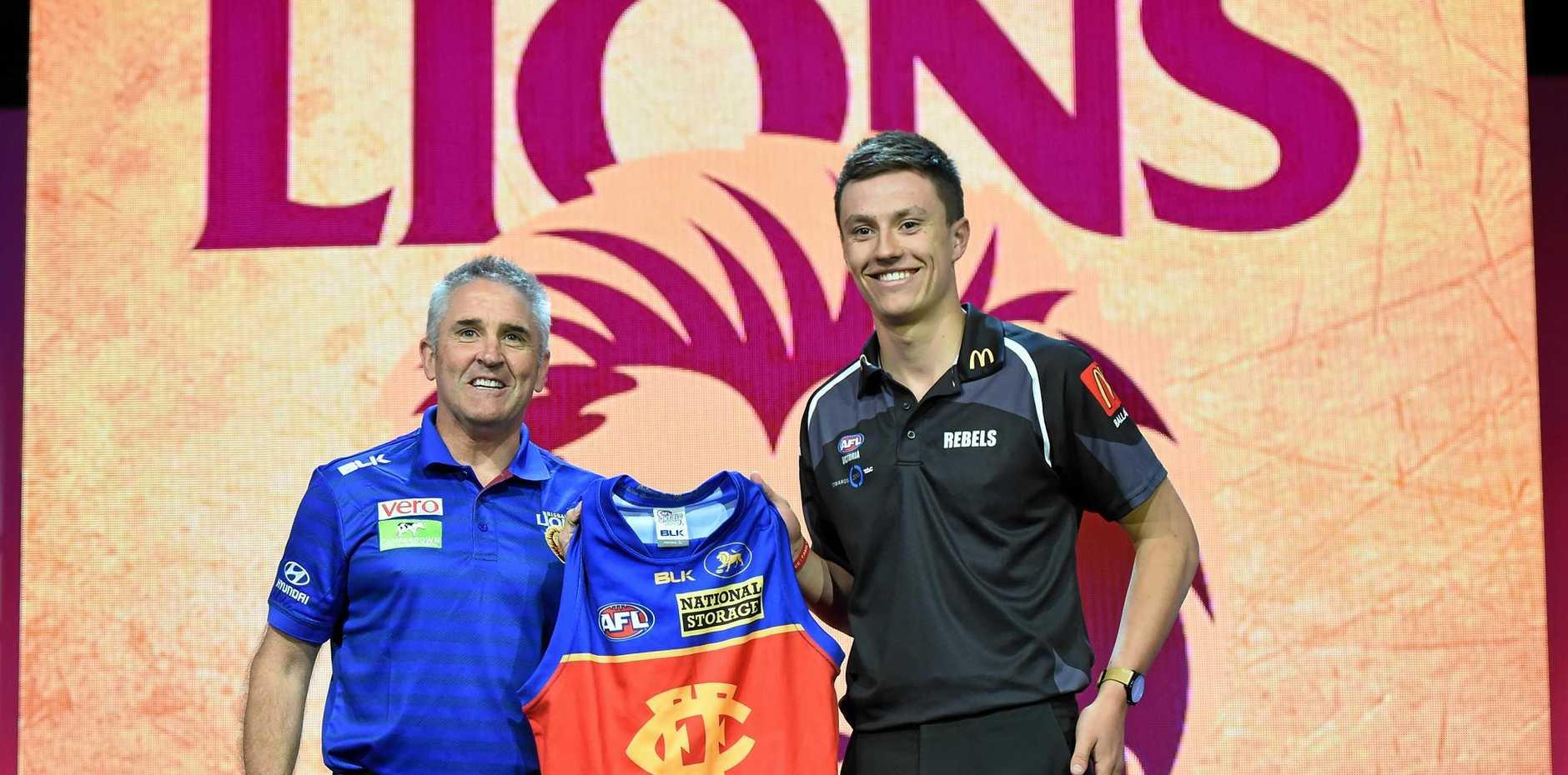 Hugh McCluggage (right) with the Brisbane Lions coach Chris Fagan.