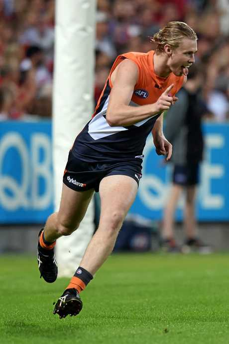 Cam McCarthy celebrates kicking a goal for the Giants.