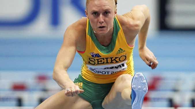 Australia's Sally Pearson clears a hurdle.