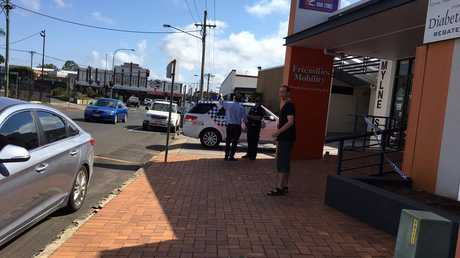 Police rope off the Discount Drug Store on Mylne St after an armed robbery in Toowoomba this morning.