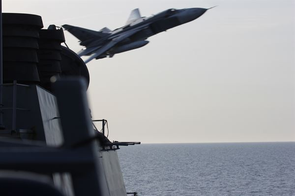 A Russian Sukhoi Su-24 attack aircraft makes a very-low-altitude pass by the USS Donald Cook in international waters in the Baltic Sea last year. The Russian military have done the same thing this week.