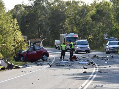 A woman was killed when the car she was driving collided head-on with a truck on Walter Hay Dr, Doonan.