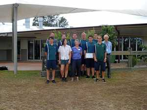 Cooroy Rotary Club presents Noosa District State High School students with $1000 cheque.