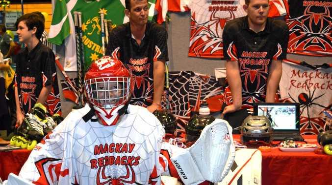 Mackay Redbacks Inline Hockey goalie Jamie Miller with international players Kris Strappazon and Zach Roberts.