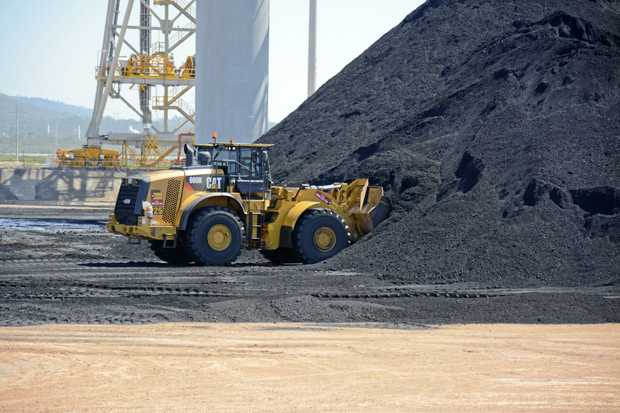 A dozer scooping up the coal at a CQ mine.