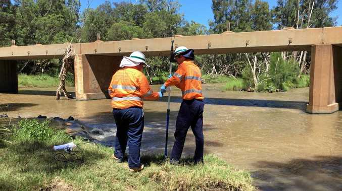 Department of Environment and Heritage Protection officers test the water in the Nogoa River, one of several sites in the Fitzroy Basin they have taken samples from this month.
