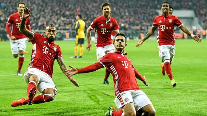 DEMOLITION JOB: Bayern Munich's Thiago celebrates after scoring a goal during his side's 5-1 UEFA Champions League rout of Arsenal.