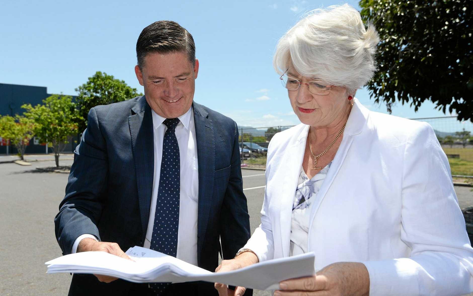Aldi Property Director Brendan Geary with Mayor Margaret Stelow looking over plans for the Aldi store which is to be built next to Fantastic Furniture on Gladstone Road.