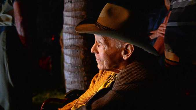 Allan Skerman attends a dawn service in Mackay.