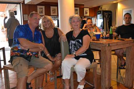 Steve Fraser, Robyn Hamilton and Robyn Mitchell excitedly watched Millionaire Hot Seat at Anchor Bar tonight.