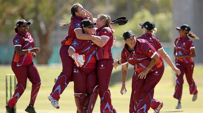 The Queensland team celebrates a wicket in the grand final of National Indigenous Cricket Championships in Alice Springs.
