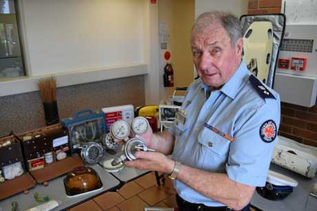 Queensland Ambulance Service heritage volunteer manager Mick Davis inspects an old oxygen flow meter on display at Caloundra station.