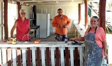 WORKING BEE: Sprucing up the old soft drink stand at the Widgee Showgrounds last Saturday are (from left) Sherry Fuller, Jarrod Clune and Mary Zahra.