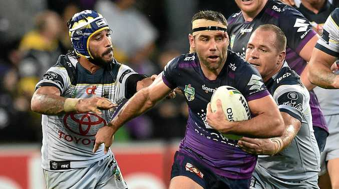 Johnathan Thurston (left) and Matthew Scott of the Cowboys and Cameron Smith of the Storm (centre) contest during the NRL Qualifying Final match between the Melbourne Storm and the North Queensland Cowboys at AAMI Park in Melbourne, Saturday, Sept. 10, 2016. (AAP Image/Julian Smith) NO ARCHIVING, EDITORIAL USE ONLY