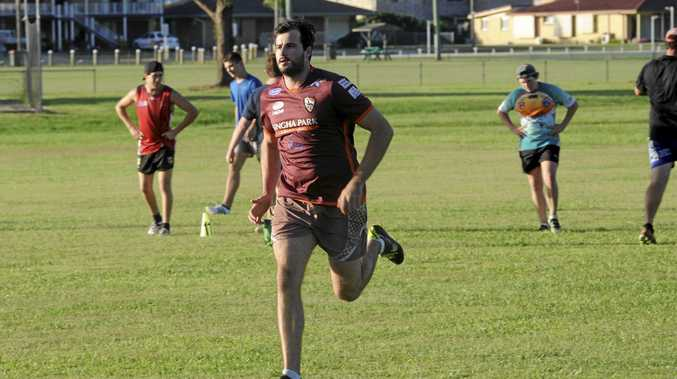 NEW FLAVOUR: Lower Clarence Magpies new recruit Alex McMillan gets miles in the legs during a recent pre-season training run at Wherret Park.