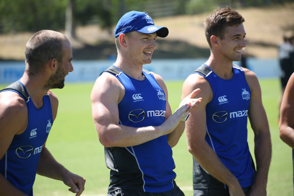 Jack Ziebell (centre) has taken the captaincy reigns at North Melbourne for 2017.
