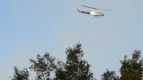 The helicopter is busy water bombing the fire near Lennox Head.