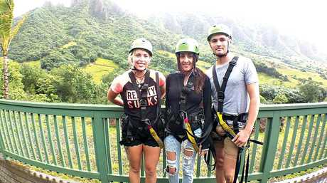 Ziplining at Kualoa Ranch are (from left) Tahneea Hoffman, Meghan Harris and Chris Burling.