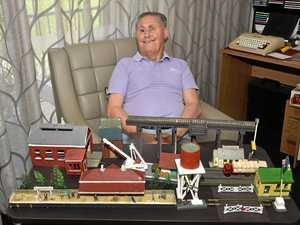 TRAIN ENTHUSIAST: Noel Walker builds his miniature models in his home at Arcare in Caboolture.
