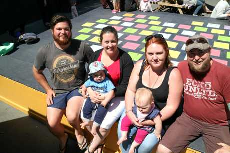 From left, Mitch Archbold, 24, Monique Poulter, 24 holding Jacob Archbold, 1, Caitlin Stockman, 24, holding Madison Gibb, eight months and Craig Gibb, 35, at the Re:Start Mall in Christchurch.