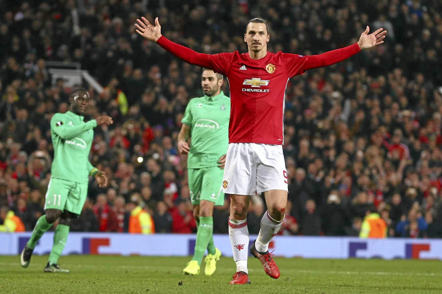 Manchester United's Zlatan Ibrahimovic celebrates after scoring during the Europa League round of 32 first leg match against Saint-Etienne at Old Trafford.