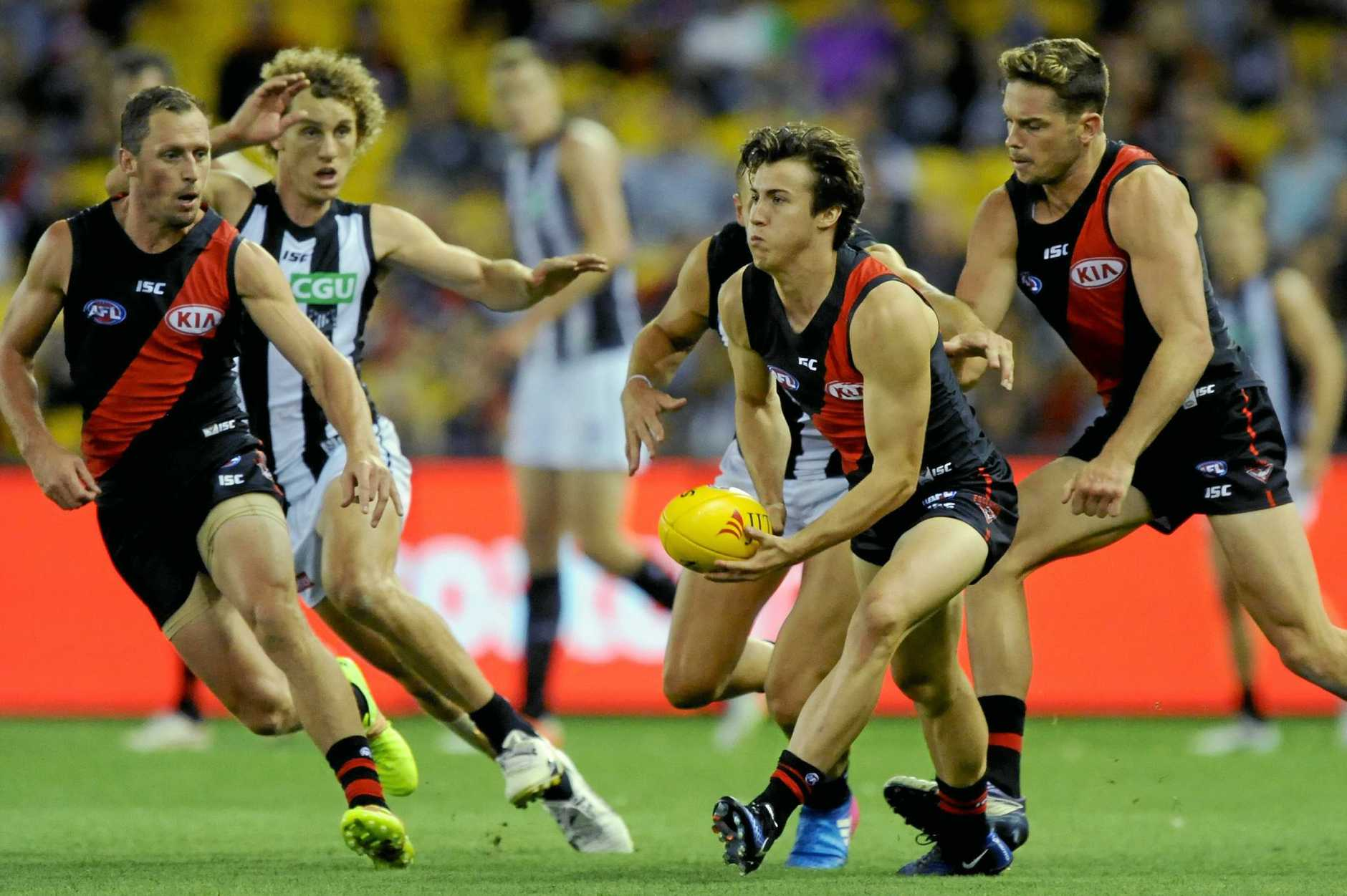 Andrew McGrath of the Bombers with the ball during the JLT Community pre-season match between Essendon and Collingwood.
