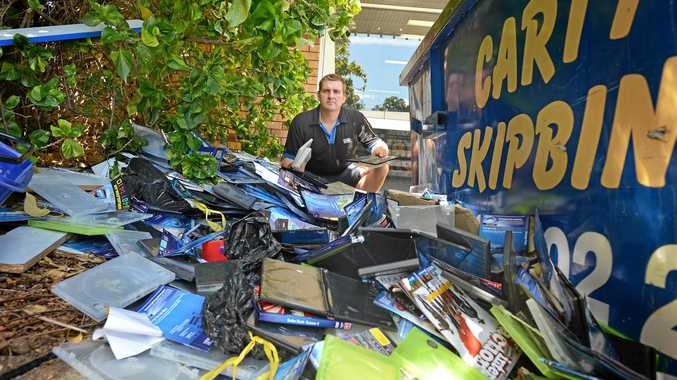 LOW-BLOW: Blockbuster Gympie David Kendall was in shock to find the outside of Blockbuster trashed.