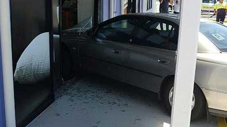A car has crashed into the Lincraft building in Maroochydore.