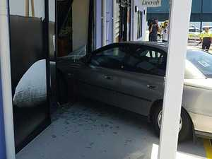 P-Plate driver crashes into business