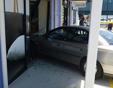 A car has crashed into the Lincraft building in Maroochydore.