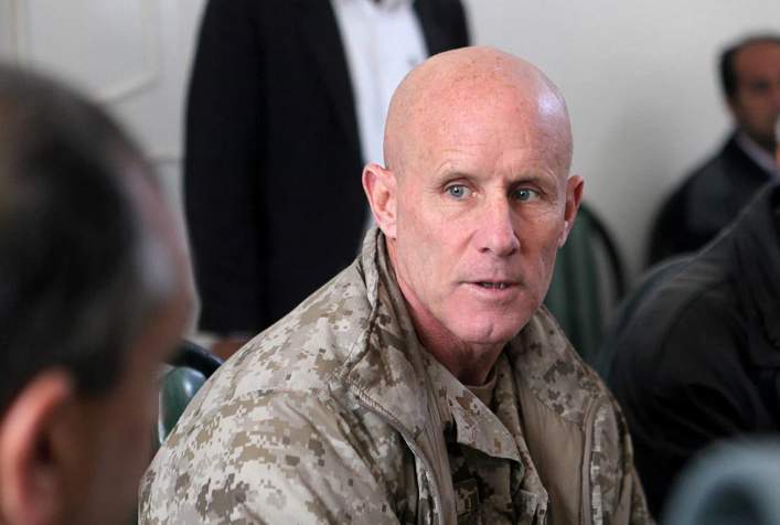 In this image provided by the U.S. Marine Corps, Vice Adm. Robert S. Harward, commanding officer of Combined Joint Interagency Task Force 435, speaks to an Afghan official during his visit to Zaranj, Afghanistan, Jan 6, 2011. Harward has turned down an offer to be President Donald Trump's new national security adviser, the latest blow to a new administration struggling to find its footing. A seni