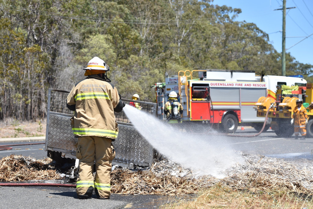 Trailer load of cane mulch catches fire on River Heads Rd near Maddever Rd at Booral. QFRS and the Booral rural firies put the flames out.